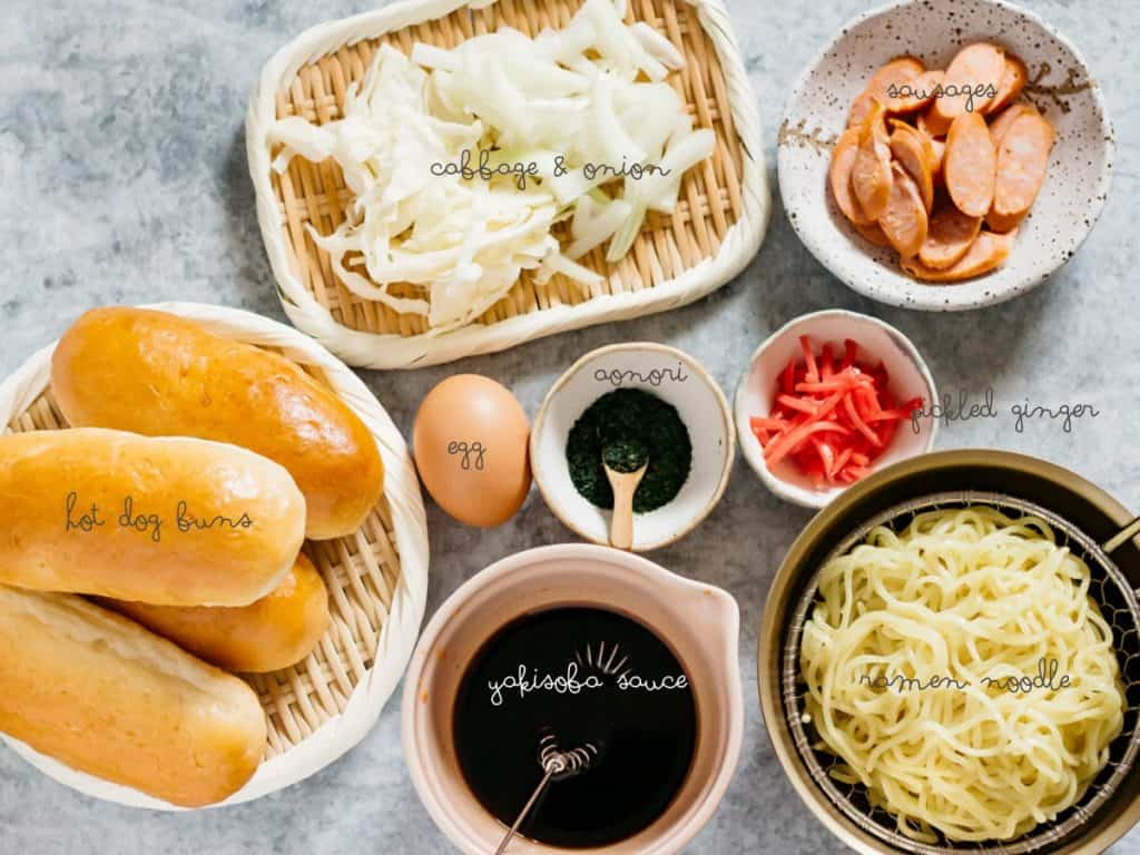 Hot dog buns, cabbage and onion, yakisoba sauce, ramen noodle, red pickled ginger, aonori seaweed flake, sausage