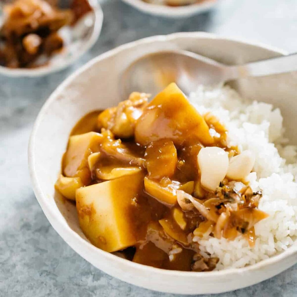 Japanese curry served with plain cooked rice in a bowl