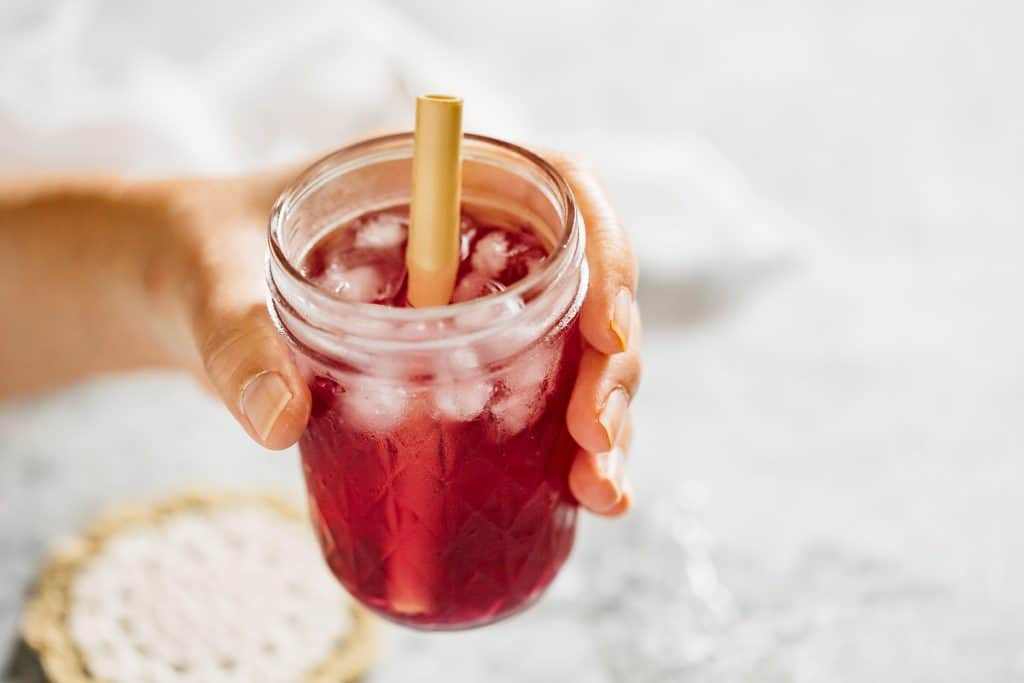 hand holding a glass of shiso juice