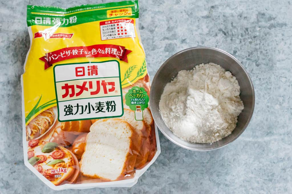 bakers flour packet and flour in a bowl