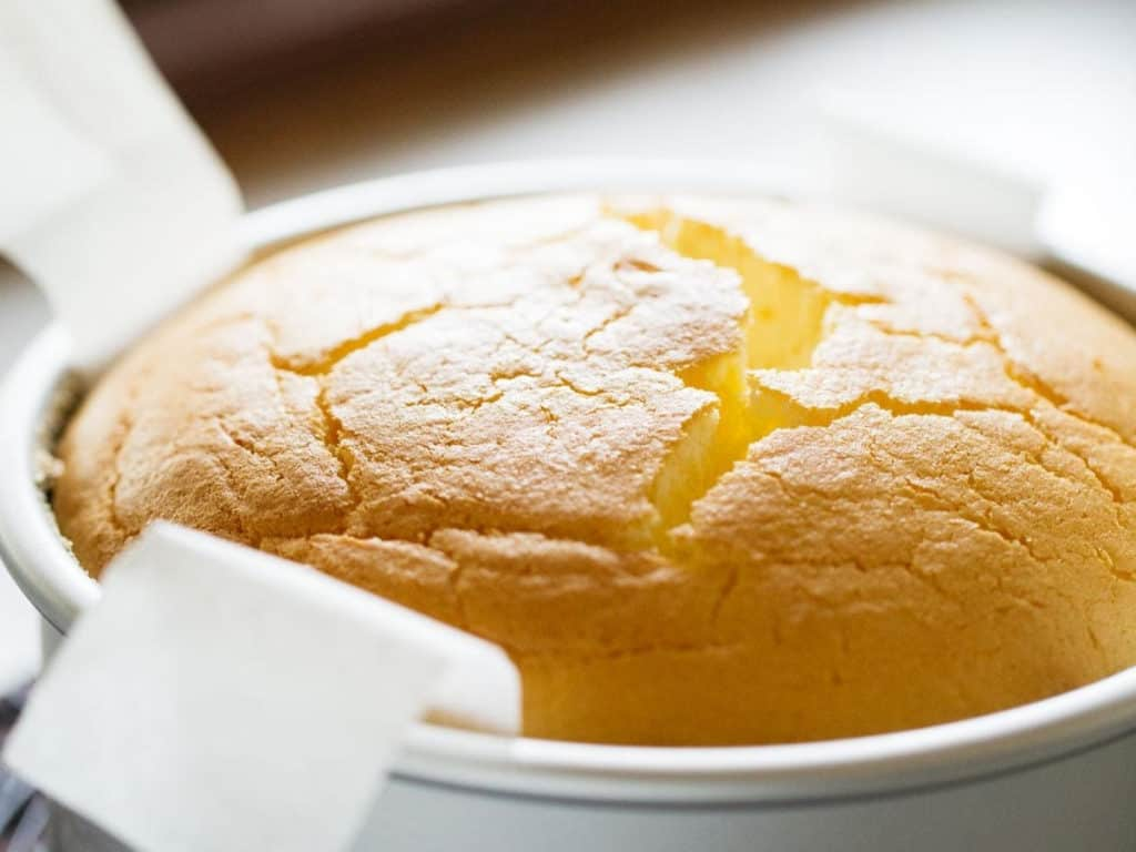 Japanese cheesecake in cake pan, the top cracked