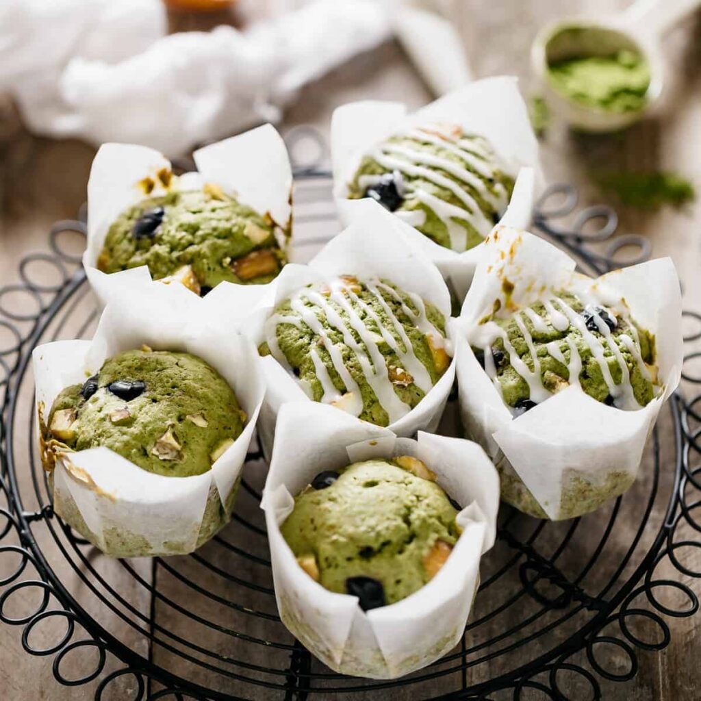 6 matcha muffins on a black cooling wire rack