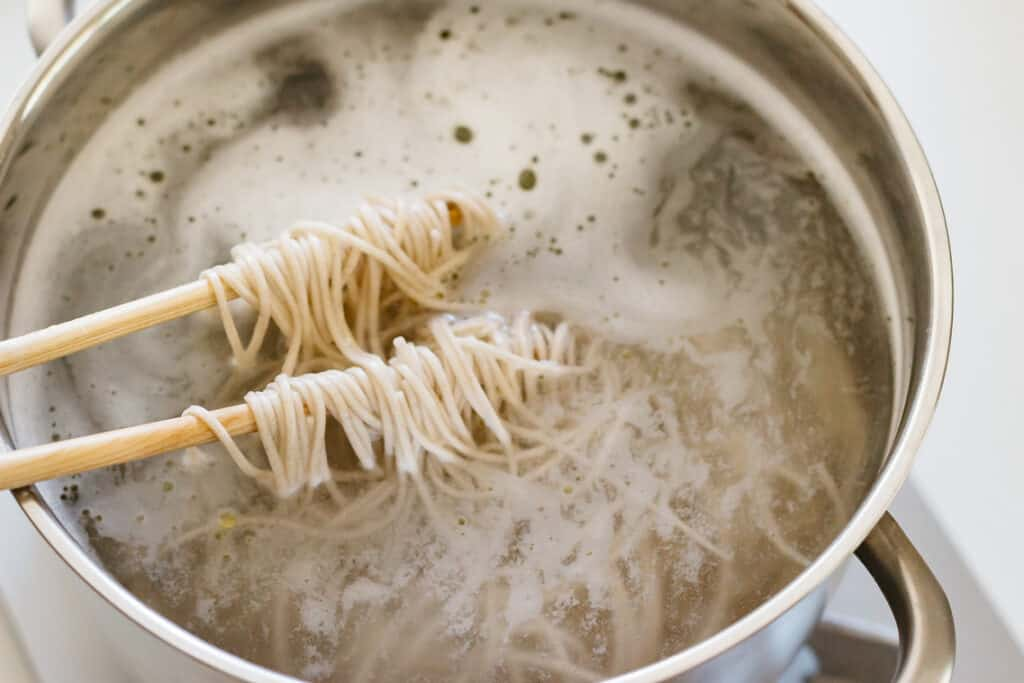 Noodles being cooked in a pot