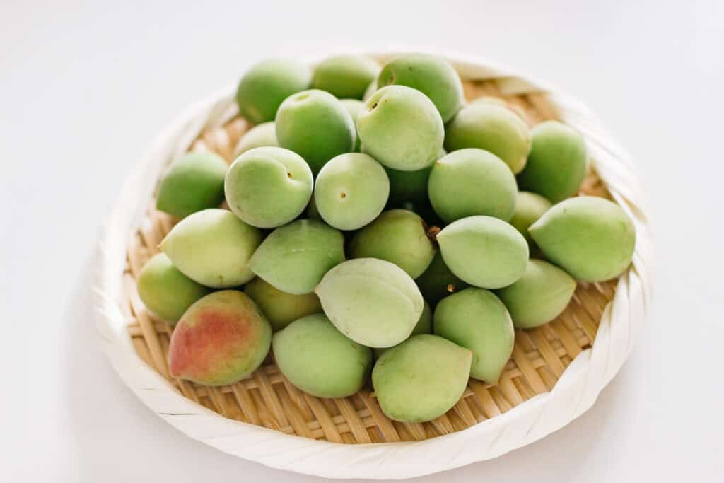 Ume plum fruits on a round bamboo tray