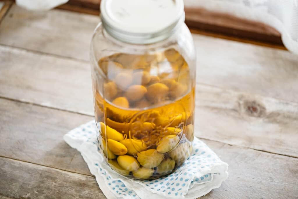 Plum wine in a glass jar