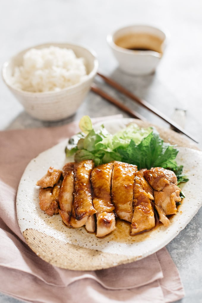 Teriyaki Chicken served on an oval plate with a bowl of plain rice