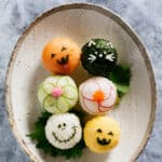6 halloween temari sushi on an oval plate