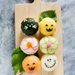 Bird view of Halloween temari sushi on a wooden plate