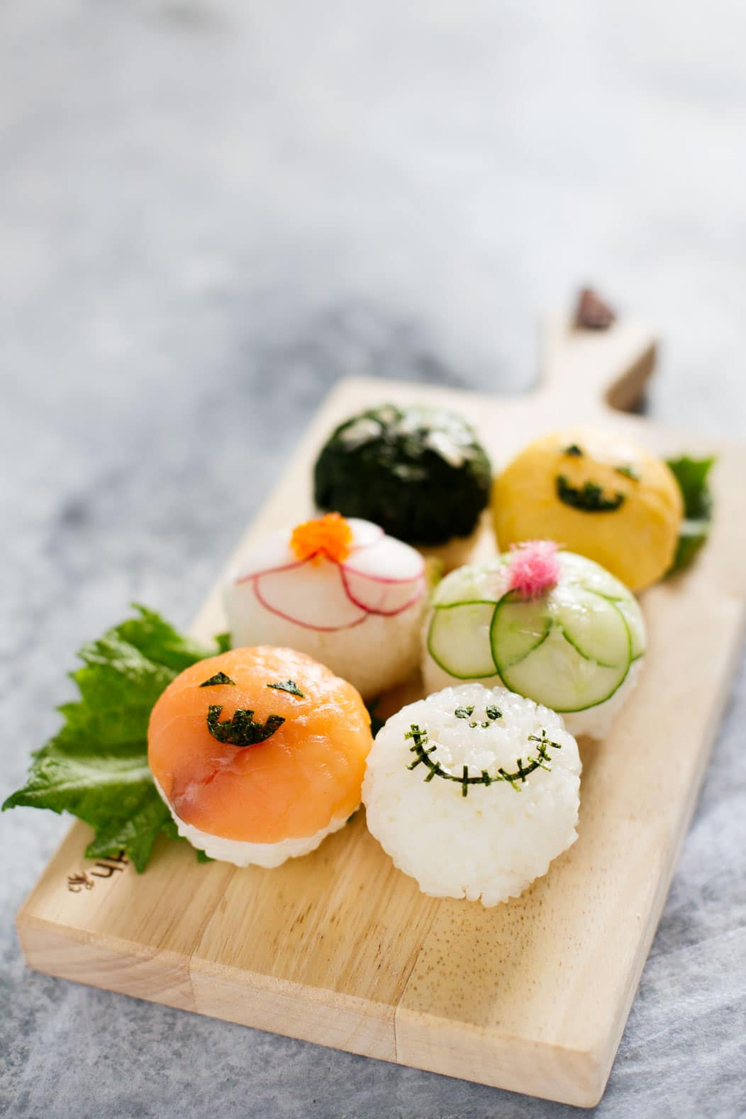 6 halloween temari sushi on a wooden plate