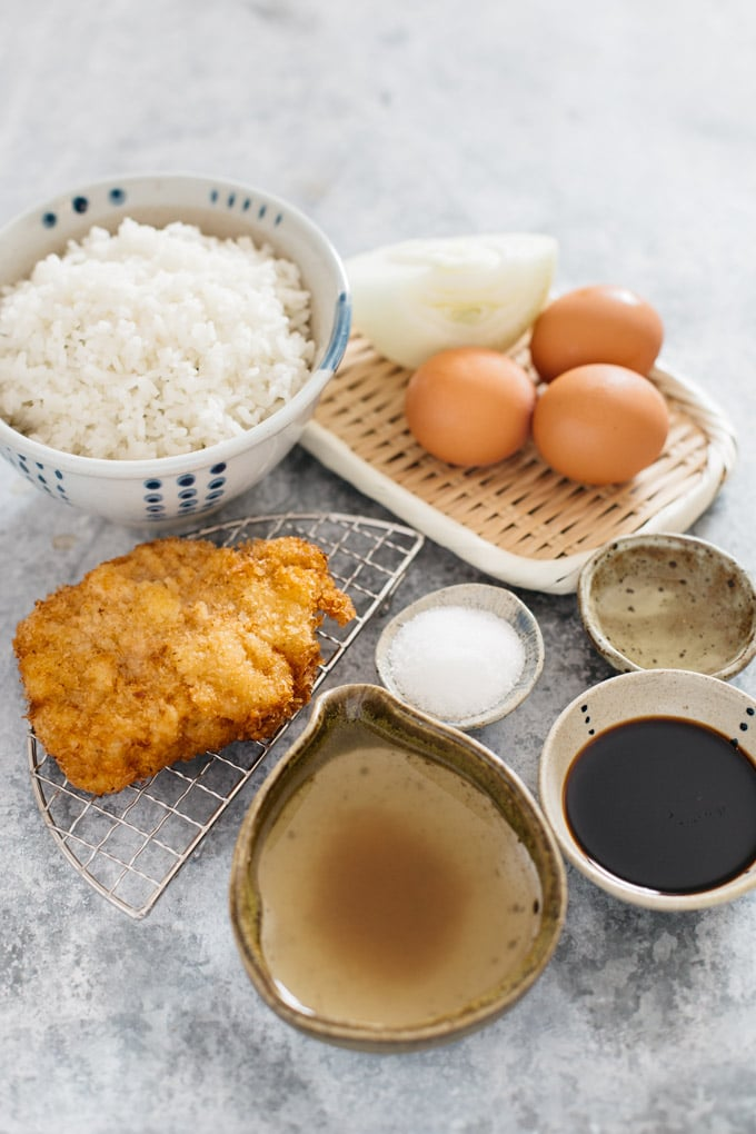 Katsudon ingredients-katsu, eggs, cooked rice, sugar, mirin, and soy sauce