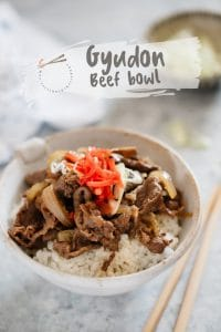 Gyudon Japanese beef bowl served with a pair of chopstick