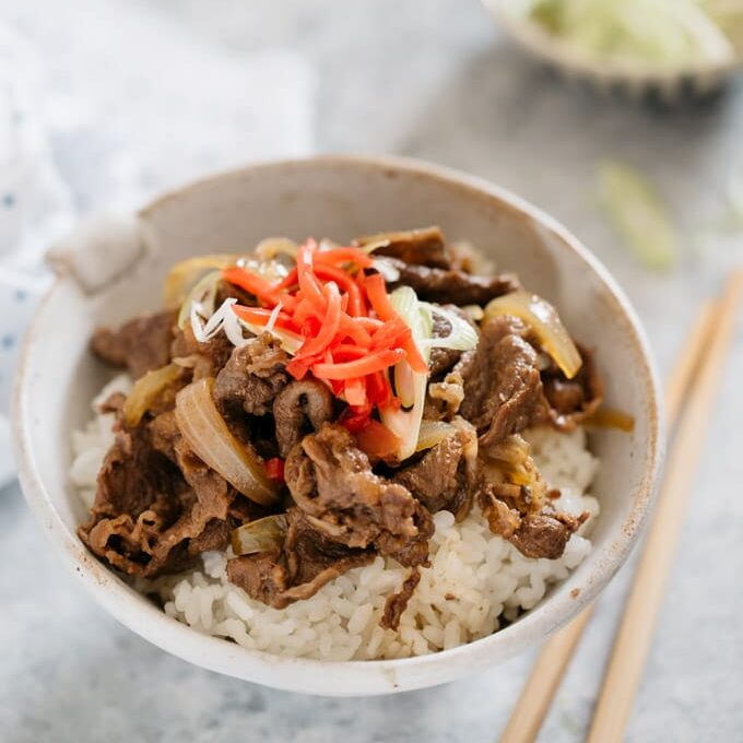 Gyudon served in a large Japanese rice bowl topped with red pickled ginger