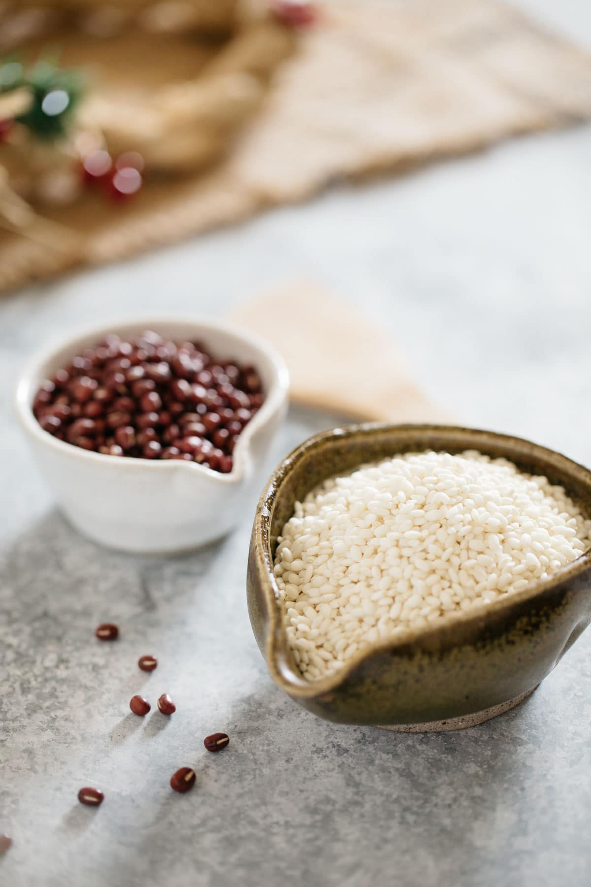Sekihan ingredients in a two small bowls, azuki beans and glutinous rice