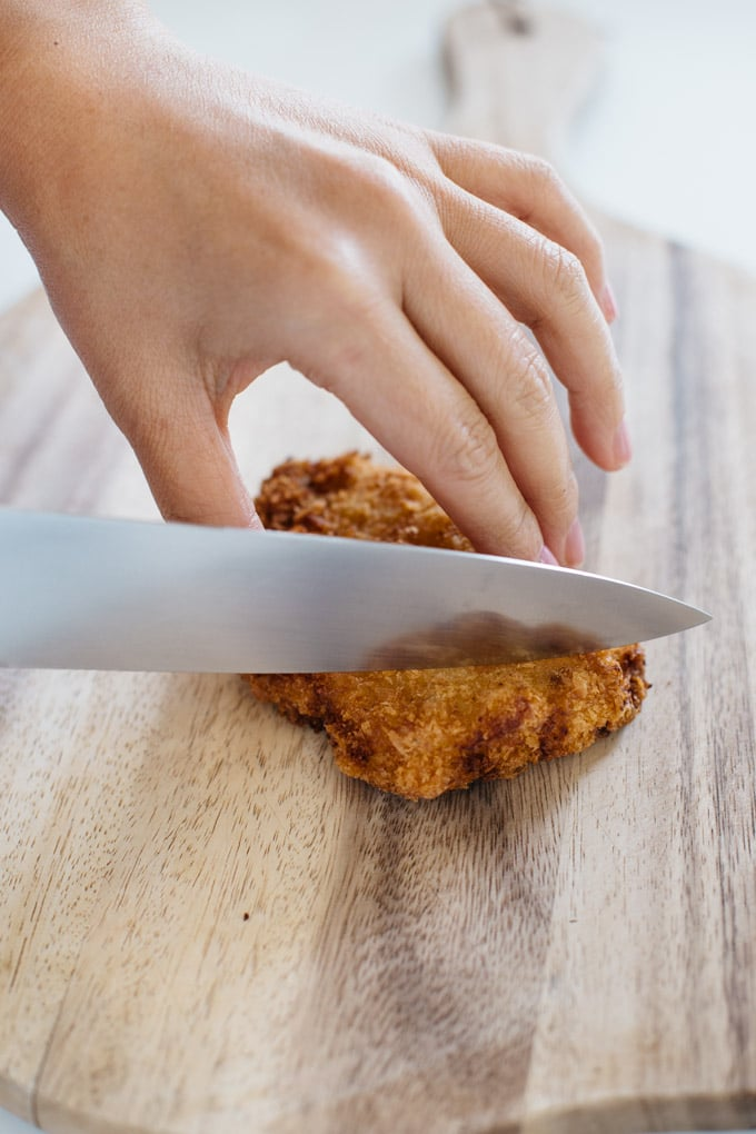 panko crumbed pork cutlet being sliced