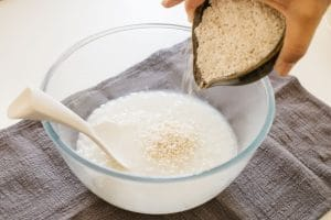 adding rice koji into the bowl