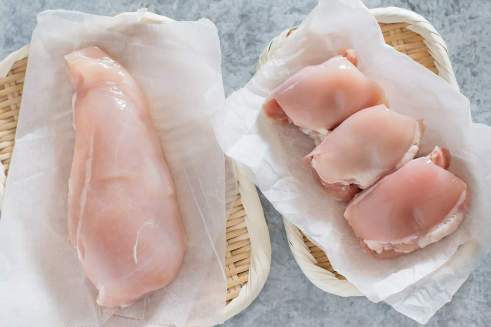 chicken breast on left and three chicken thigh on right