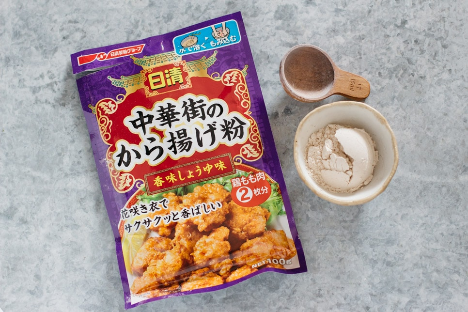 karaage mix package on left and powder in a small bowl on right