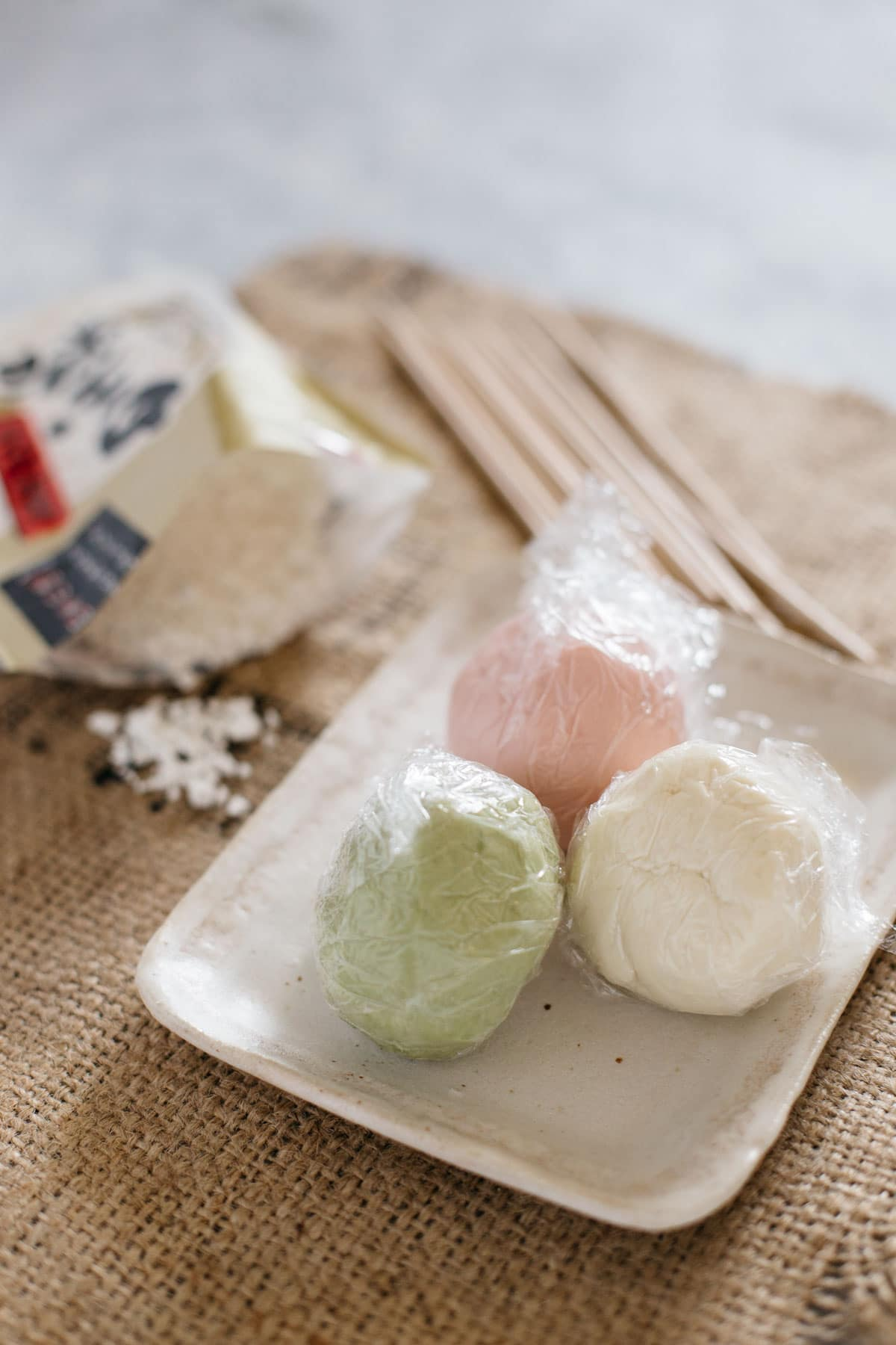 three different coloured dango dough, white, green and pink