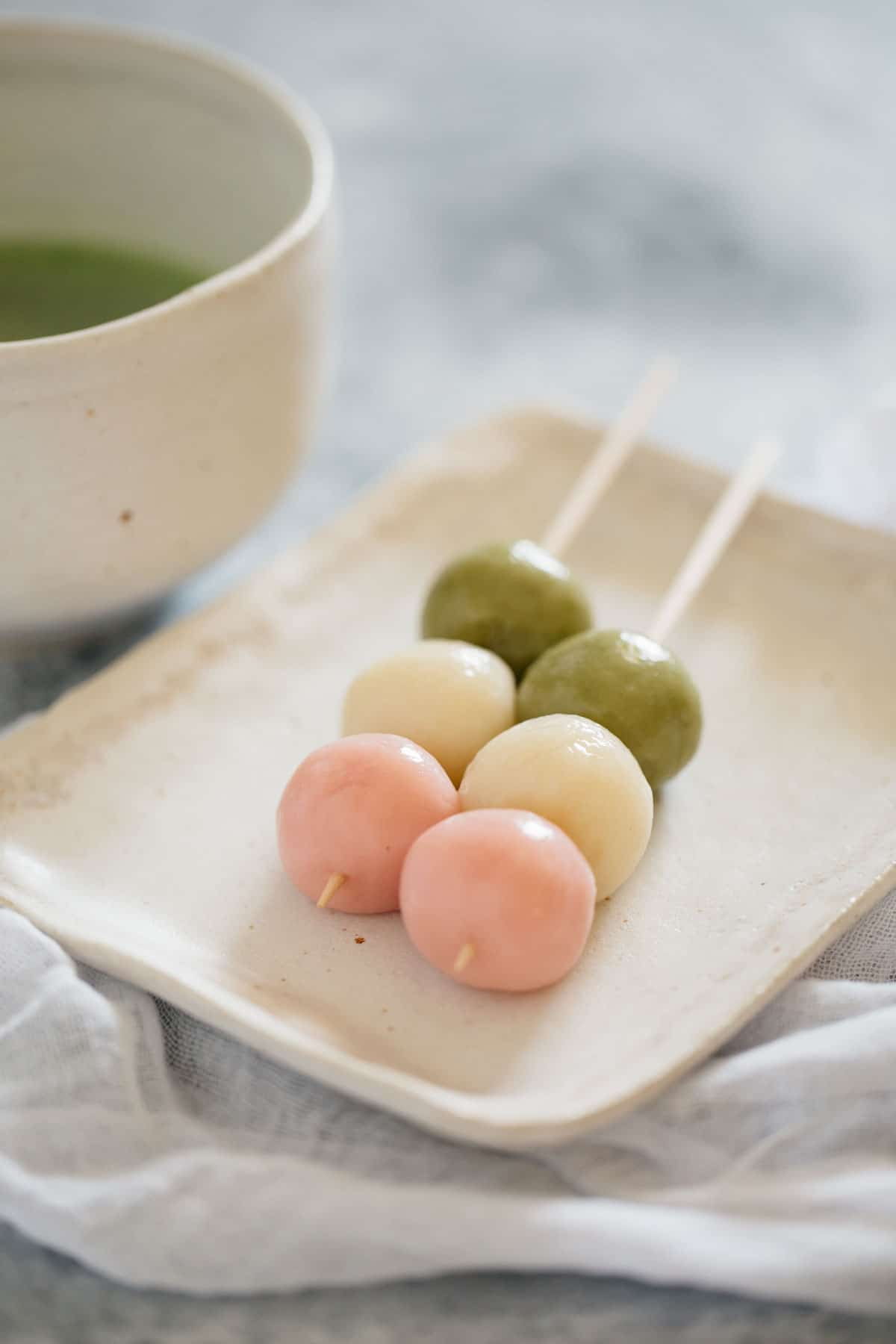 Two three coloured dango on skewers