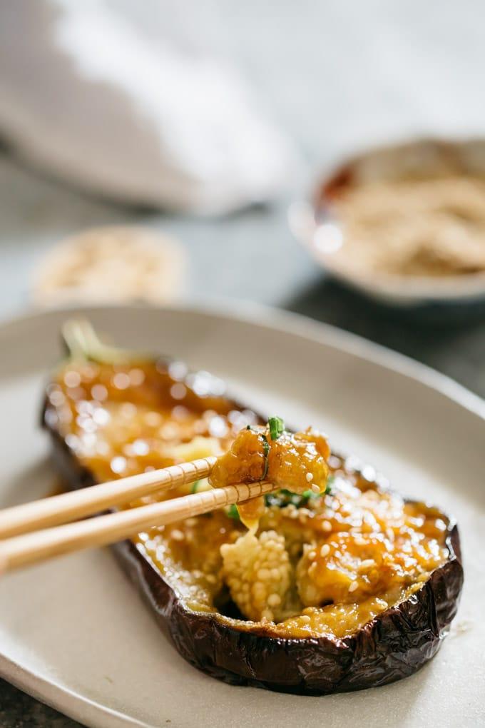 A pari of chopstick scooped miso eggplant