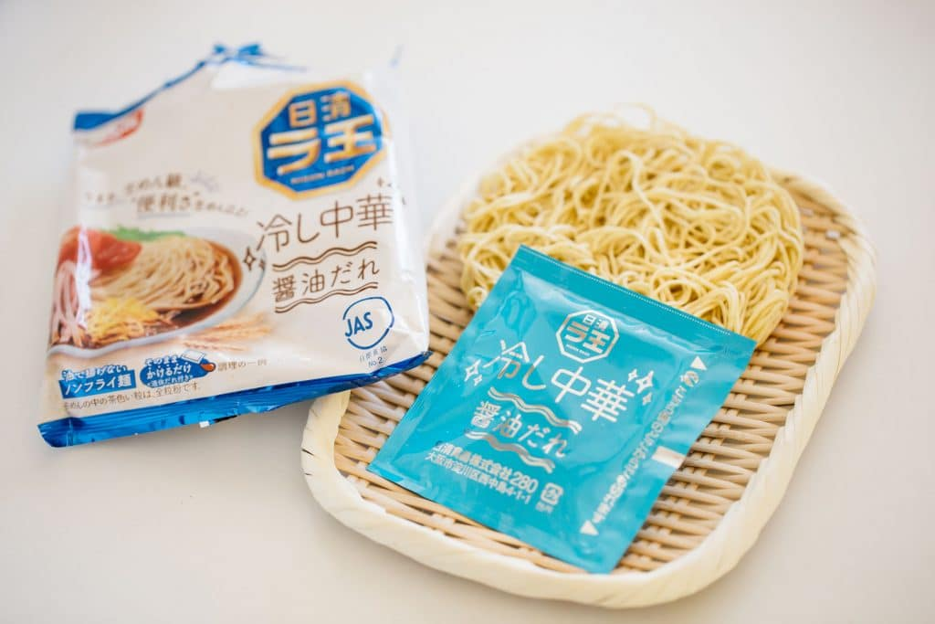 dry ramen noodle and a sauce sachet and a package