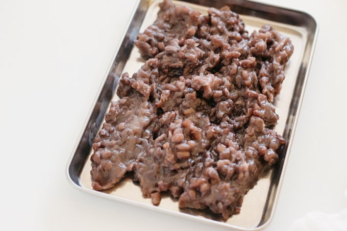 Cooked red bean paste cooking down on a stainless steel tray