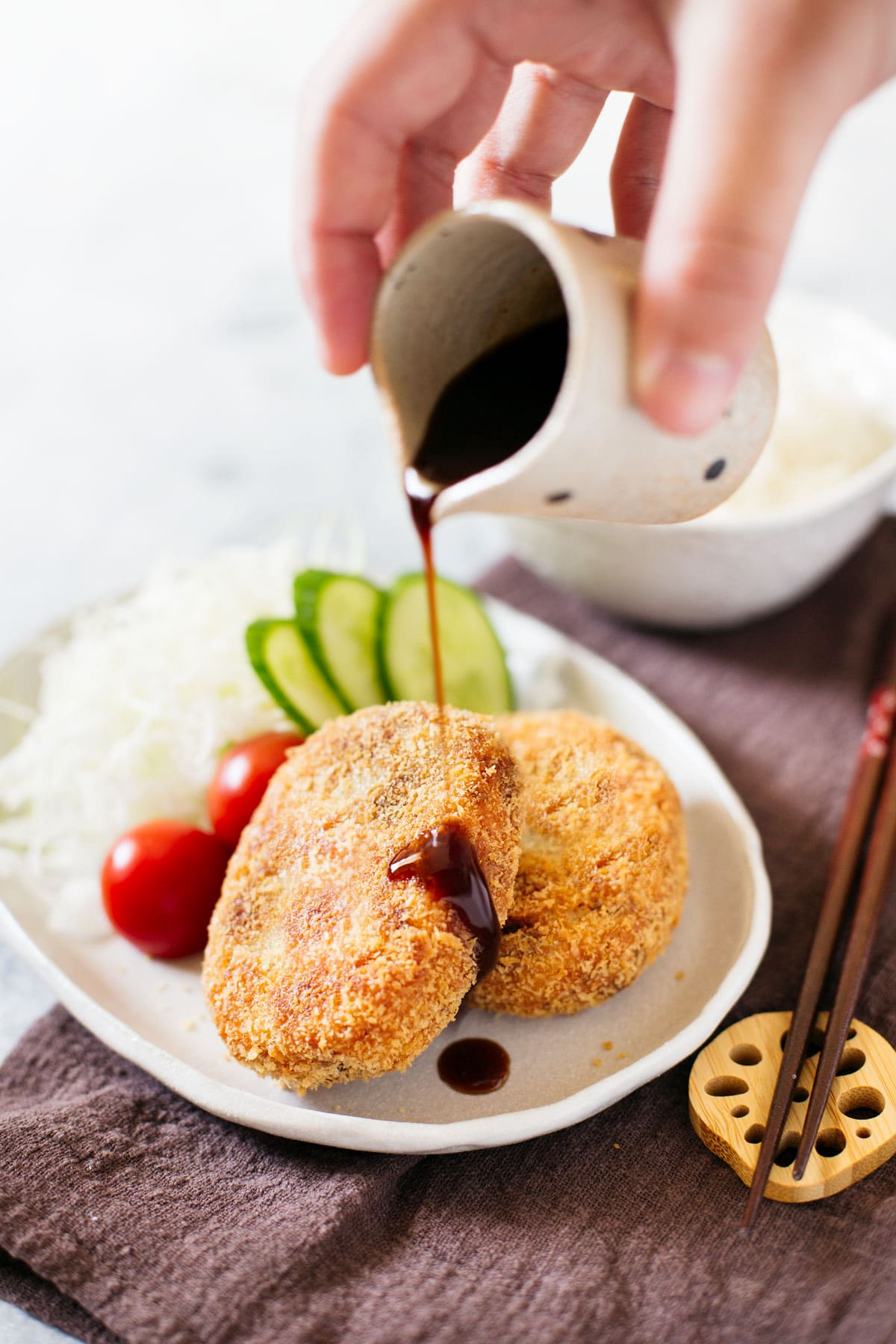 Tonkatsu sauce poured over Japanese potato croquettes