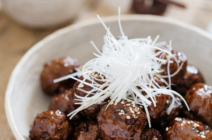 Teriyaki meatballs served in a Japanese pottery shallow bowl