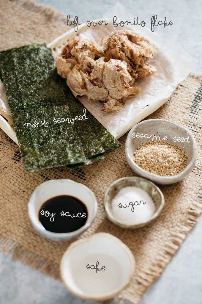left over bonito furikake, nori sheets, sesame seeds, sugar, sake and soy sauce in small bowls