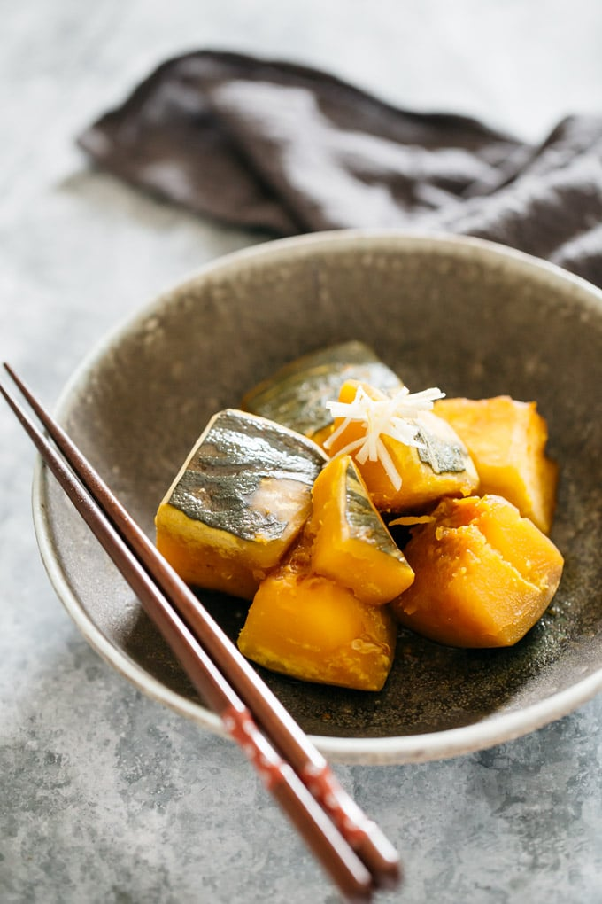 simmered kabocha squash served on a round shallow bowl
