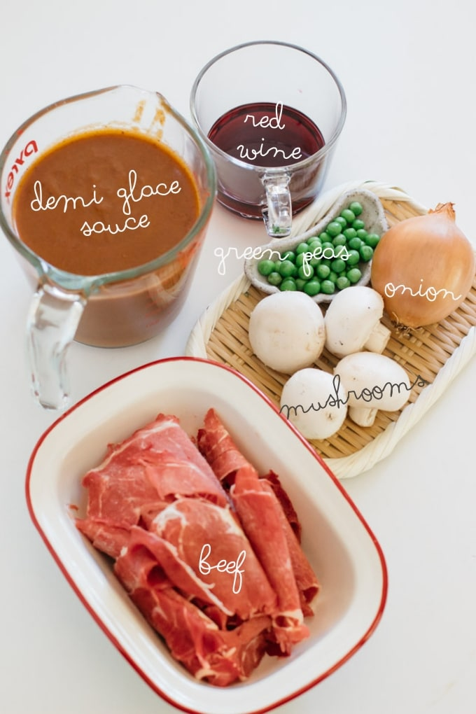 thinly sliced beef, demi glace sauce, red wine, green peas, 4 mushrooms, 1 onion