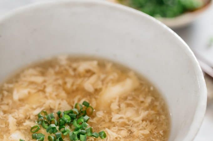 egg drop soup served in a large Japanese pottery bowl