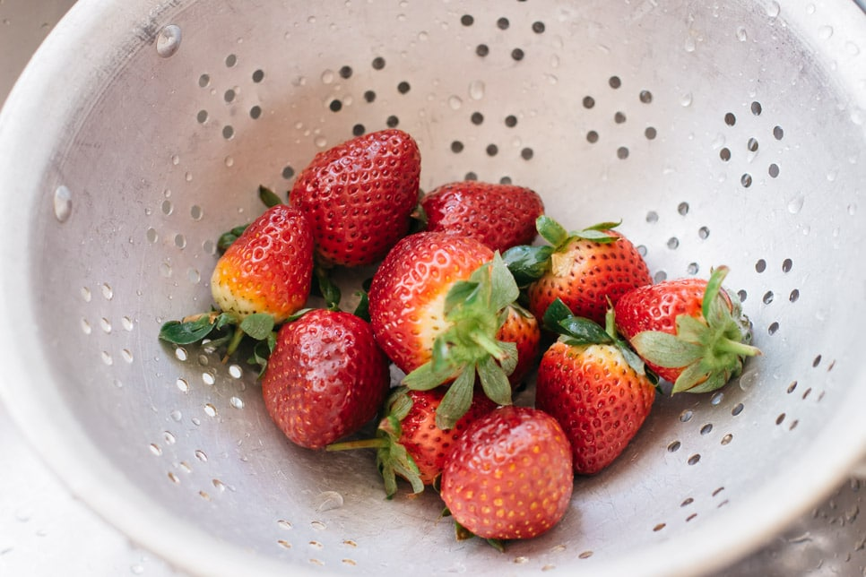 Strawberries washed and in a colander