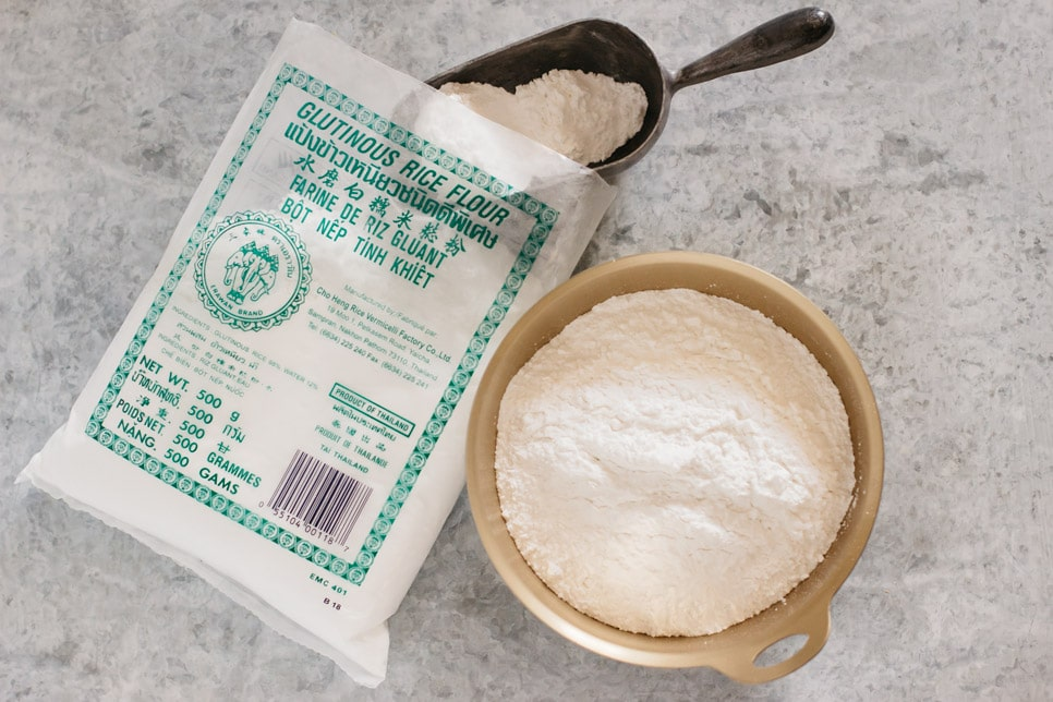 Glutinous rice flour packet and flour in a large bowl