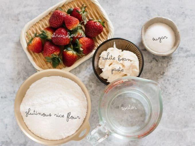 strawberries, sugar, glutinous rice flour, white bean paste, and a jug of water