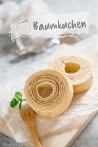 two slices of Baumkuchen on a wooden board