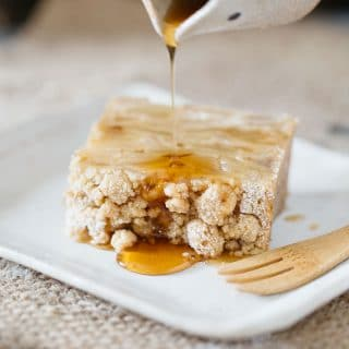 maple syrup poured over invisible apple crumble cake