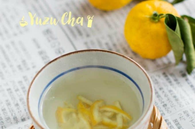 Yuzu Cha served in a small tea bowl and three yuzu citrus