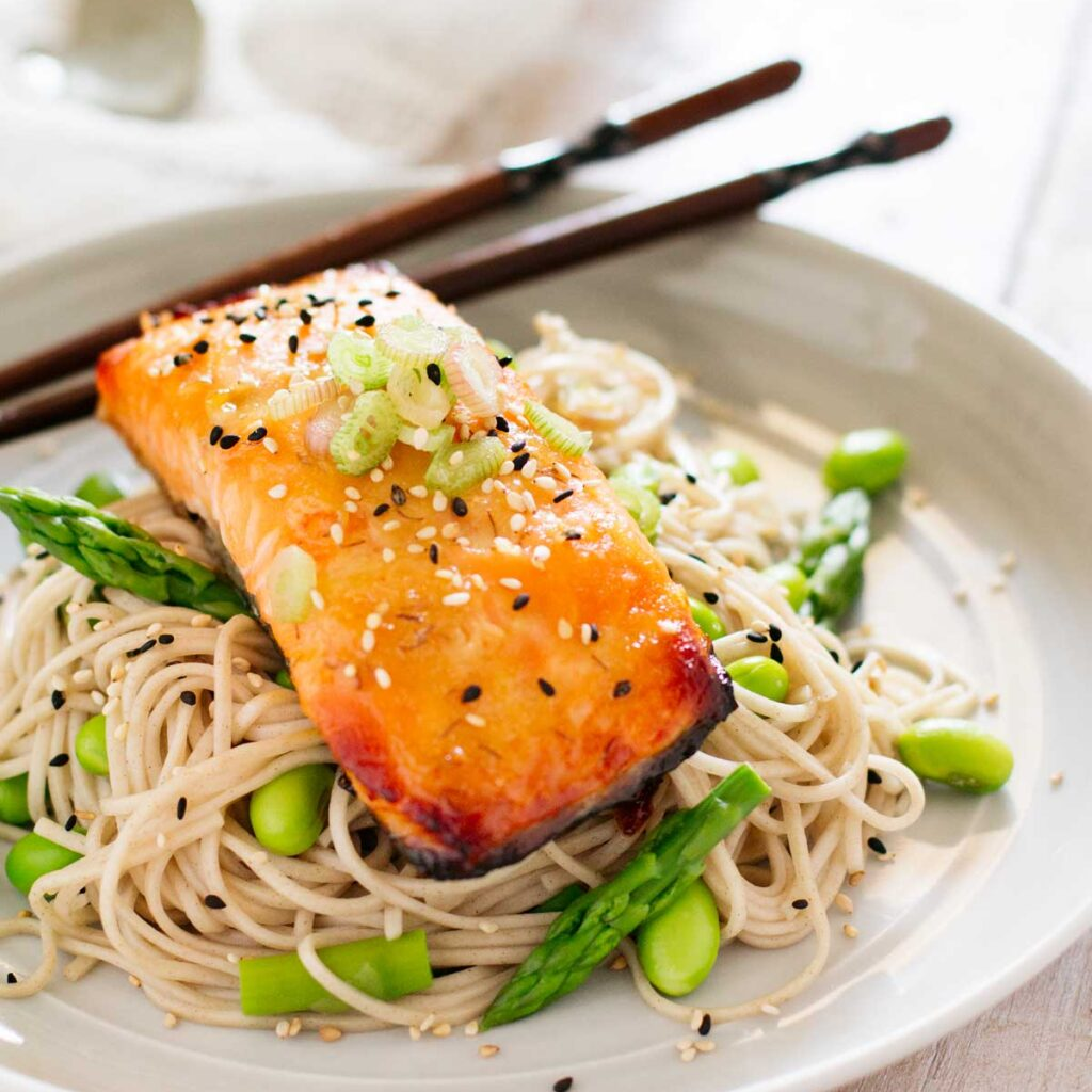Miso glazed salmon served on soba noodles with edamame beans