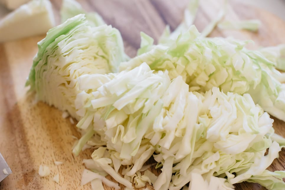 shredded cabbage on a chopping board