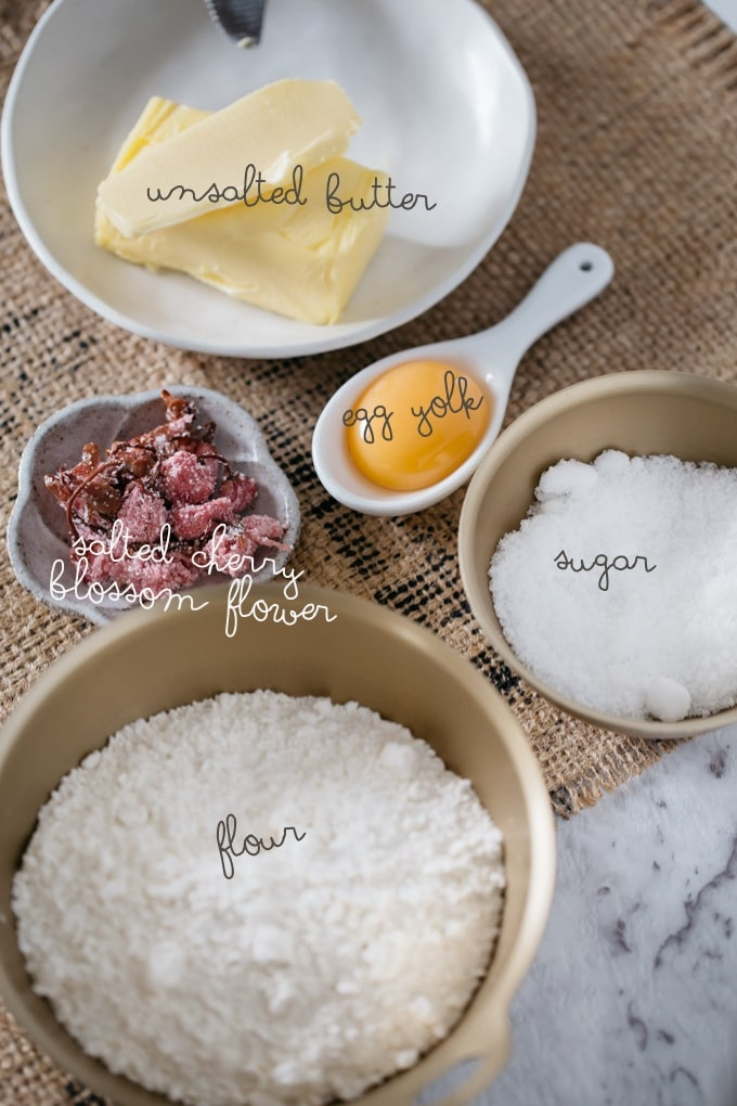 ingredients of Sablé cherry blossom flower-flour, sugar, butter, egg yolk, salted cherry blossom flower