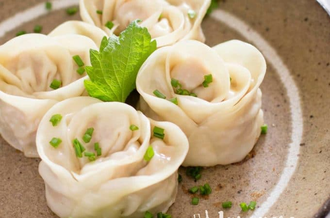 4 Japanese Gyoza Rose served on a brown plate