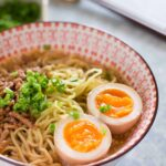 Tan tan ramen served in a bowl with miso egg and pork mince