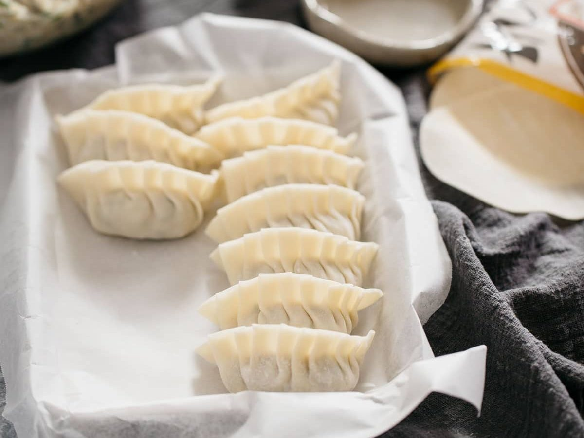 10 Japanese gyoza wrapped and waiting to be cooked