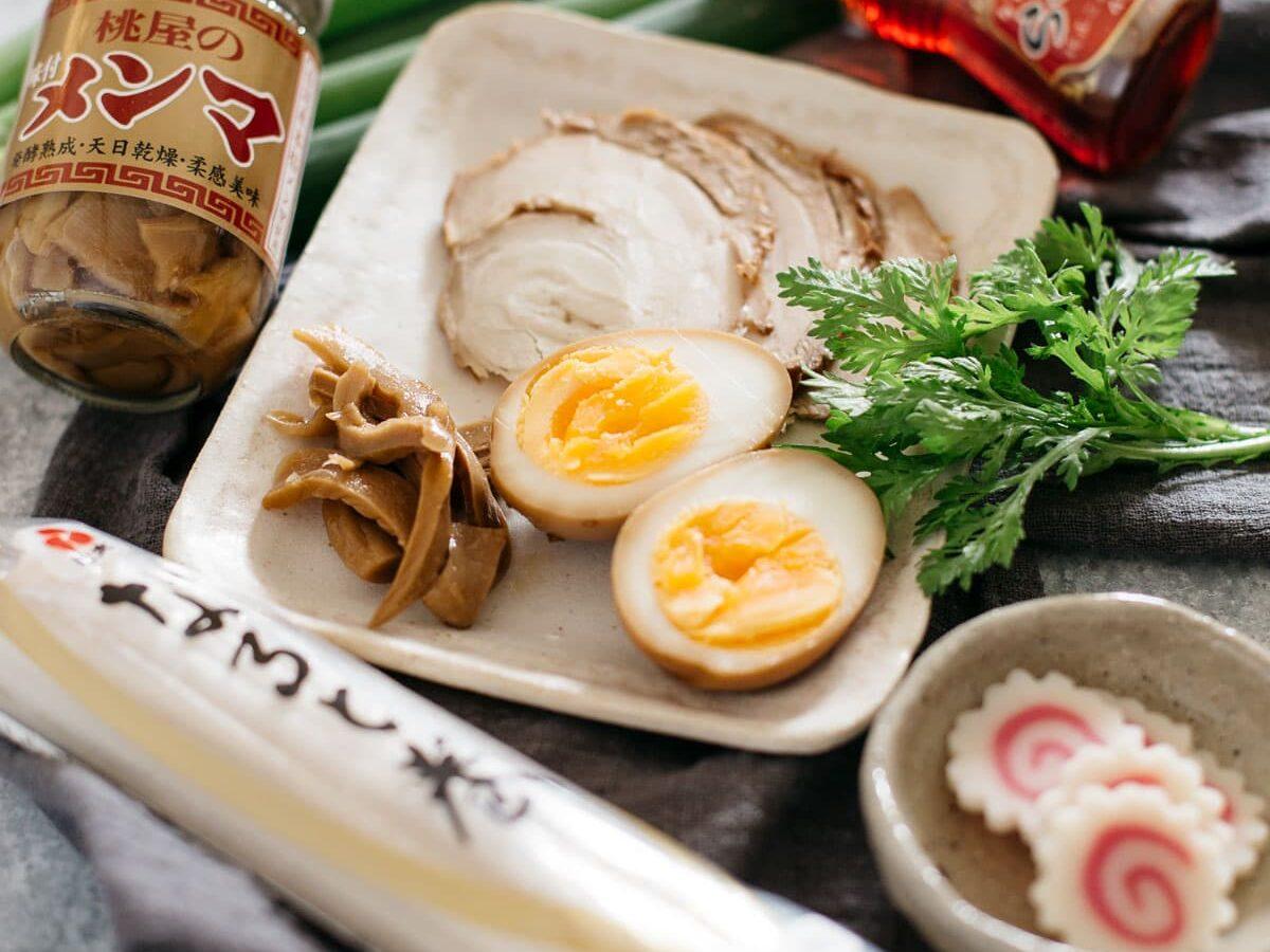 Shio ramen ingredients -shungiku, ramen eggs, chashu and na ruto