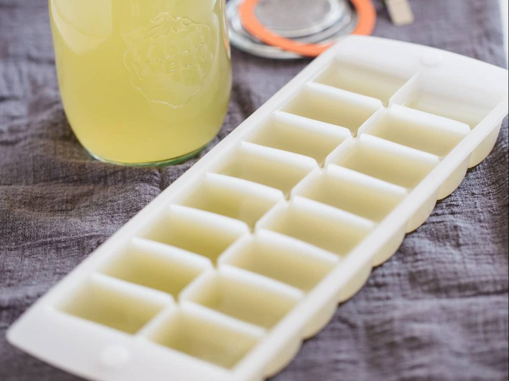 Dashi stock in a 750ml jar and an ice cube tray