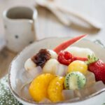 Anmitsu, Japanese cold dessert served in a small Japanese potter bowl with various fruit. mochi and azuki bean paste