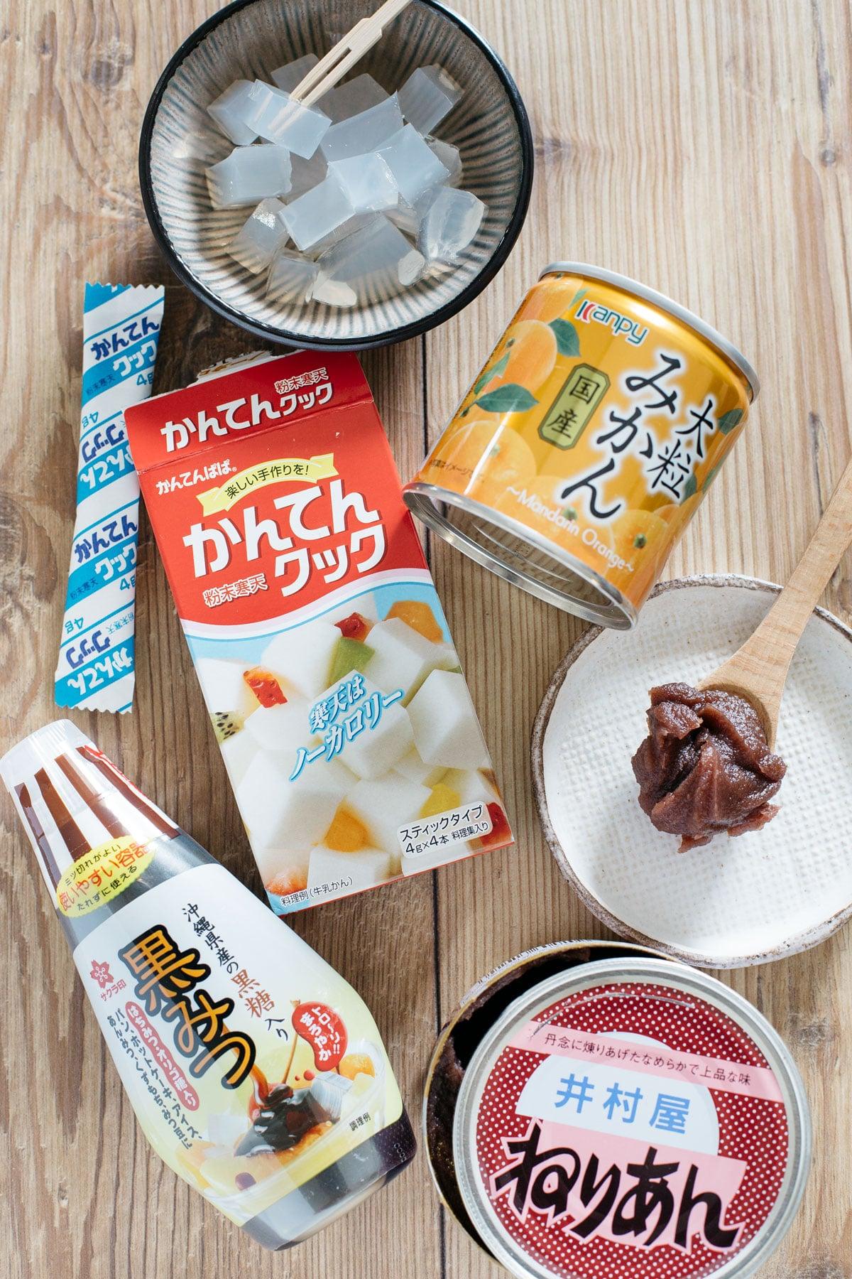Anmitsu topping ingredients, kanten jelly, azuki bean paste, brown sugar syrup, and caned madarin