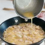 stirred eggs poured over chicken and onion simmered in seasoing liquid