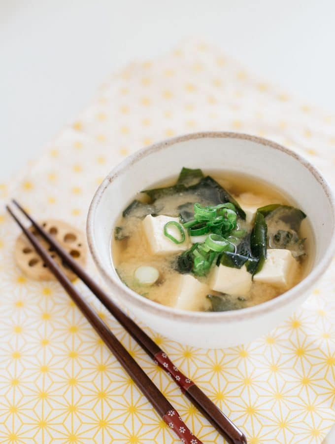 Japanese miso soup is served in Japanese pottery bowl and chopsticks